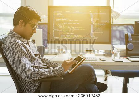 Indian Software Engineer Working In Sunny Office