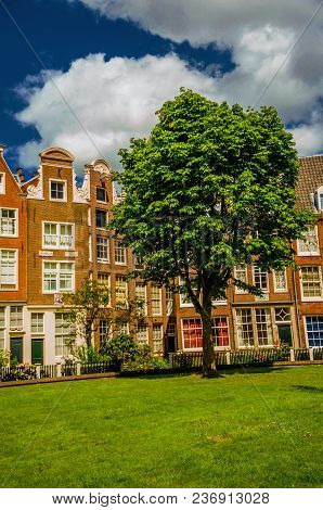 Semidetached Houses And Garden At Begijnhof, A Medieval Semi-monastic Community In Amsterdam. Famous