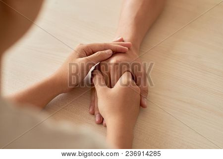 Person Touching Hand Of Friend To Support Him
