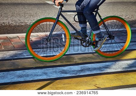 A Cyclist In The City Goes On A Pedestrian Crossing. Eco-friendly Mode Of Transport