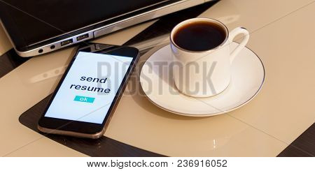 A Smartphone And An Inscription Send Resume. On The Table Is A Laptop And A Cup Of Coffee. Can Illus