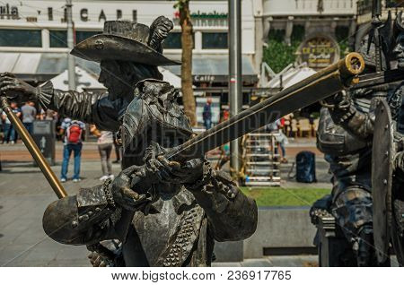 Amsterdam, Northern Netherlands - June 26, 2017. Bronze Sculpture Of Xvii Century Soldiers On The Re