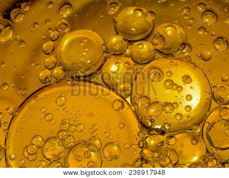 Yellow Bubble Background.oil Drops At The Yellow Background.oil Drops.abstract Background With Oil D