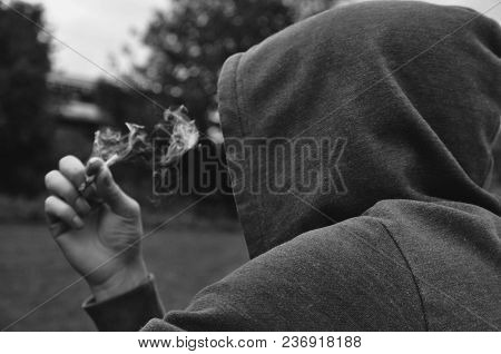 Mysterious Faceless Person Smoking Wearing A Hood