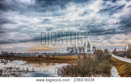 Colorful Rural Landscape With A Church At Sunset In Spring