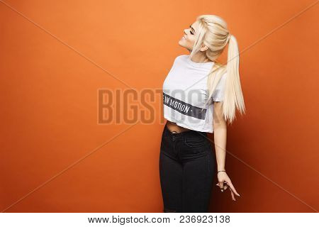 Cheerful And Smiling Blonde Model Sexy Girl With Daily Makeup And Closed Eyes, In White T-shirt And
