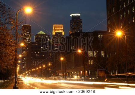 Minneapolis City Skyline At Night With Street And Moving Cars
