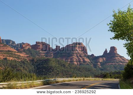 The Natural Beauty Of The Red Rock Canyons And Sandstone Of Sedona In Arizona. Road Leading Through