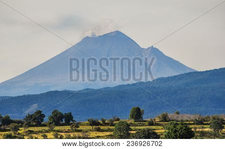 Volcano Popocatepetl In Mexico Seen From The East And Featuring Small Clouds Of Smoke Coming From It