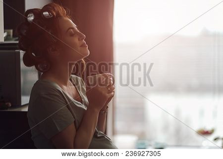 Pregnant Woman Emotions Concept. Living Feelings While Drinking A Cup Of Tea Near The Window With Ci