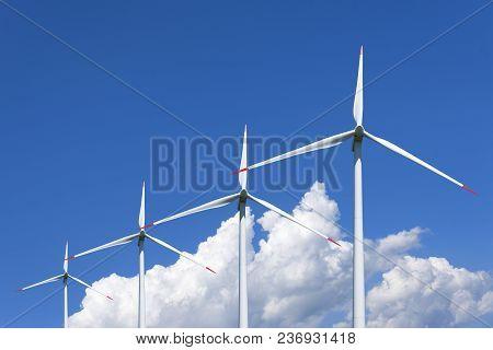 Air Mills Power Station Against The Blue Sky. Alternative Energy.
