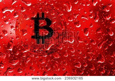 Coin Bitcoin Behind Glass With Red Drops. Blood On Bitcoin. Terrorism, War, Extortion, Crimes For Bi