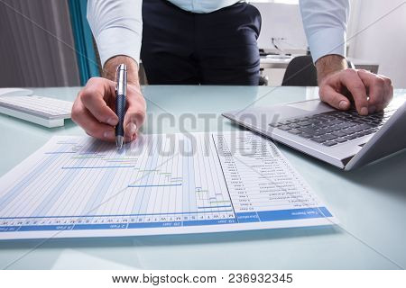 Businessperson Working On Gantt Chart