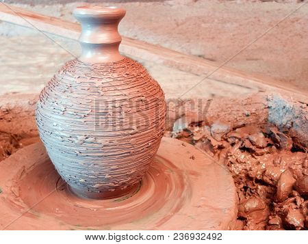 Raw Clay Vase With A Narrow Neck On The Stopped Wheel.