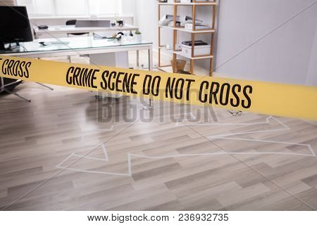 Yellow Crime Scene Tape Near Chalk Outline Of Murdered Victim