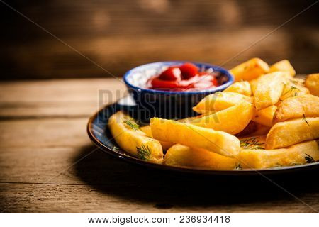 French fries on wooden table