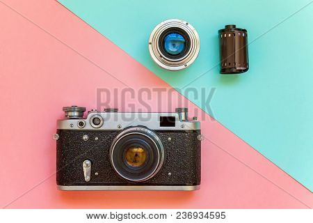 Vintage Film Photo Camera Lens Film Roll And Accessories On Pink And Blue Colourful Pastel Trendy Mo