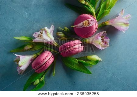 Pink Macaroons Decorated With Pink And White Alstroemeria Flowers. Romantic French Dessert On Stone