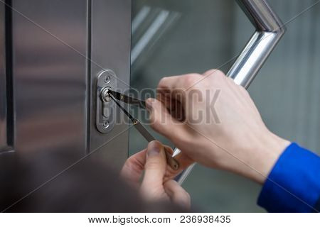 Close-up Of A Person Opening Doors