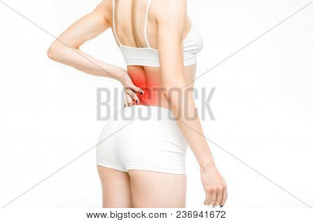 Back pain, woman with backache on white background. Female person in white lingerie, medical advertising or concept