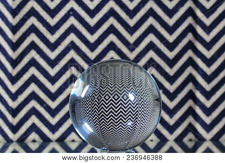 A Sphere With Pattern And Colorful Background.