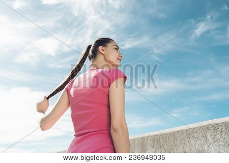 Strong Young Girl Trains Outdoors Under A Blue Sky, Getting Ready For A Run