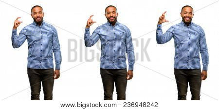 African american man with beard holding something very tiny, size concept