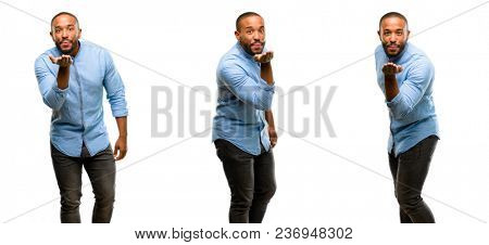 African american man with beard expressing love, blows kiss at camera, flirting