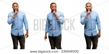 African american man with beard with index finger on lips, ask to be quiet. Silence and secret concept