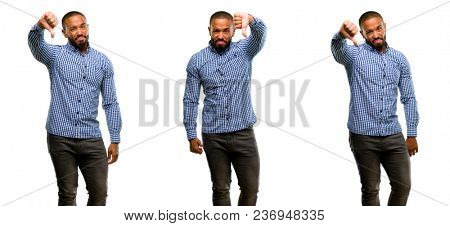 African american man with beard showing thumbs down unhappy sign of dislike, negative expression and disapproval