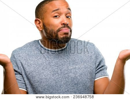 African american man with beard doubt expression, confuse and wonder concept, uncertain future shrugging shoulders isolated over white background