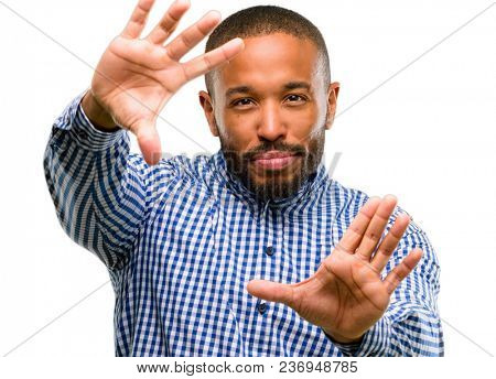 African american man with beard confident and happy showing hands to camera, composing and framing gesture isolated over white background