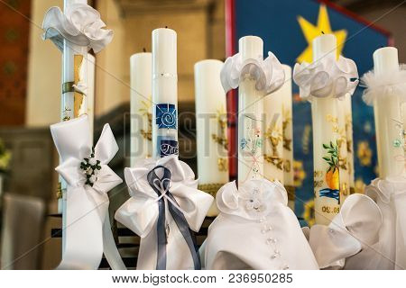 First Holy Communion Or Confirmation - Burning Candles Rowed Up In Church Before Ceremony Beautiful