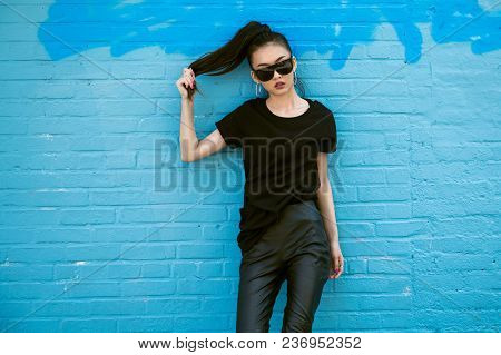 Beautiful Fashionable Asian Girl Wearing  And Black Clothes Outfit Posing In Front Of Blue Wall