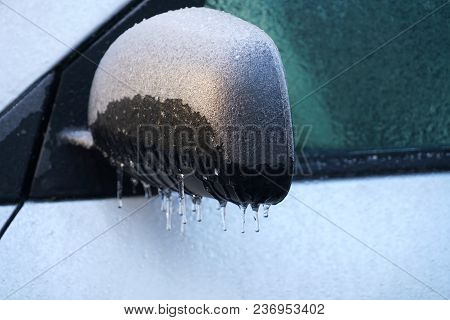 Icicle On The Car Side Mirror In Frozen Rain