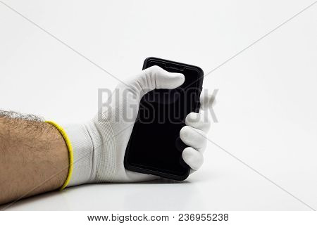 Smartphone In A Tight Hand In White Glove On White Background Isolation