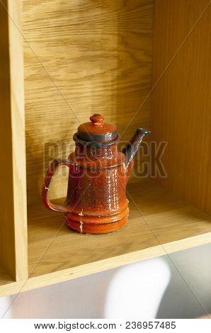 Red Vintage Ceramic Teapot On The Shelf. Interior Detail
