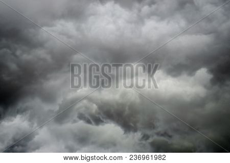 Storm. Dark Sky With Black Clouds For Background. Intentionally Blurred