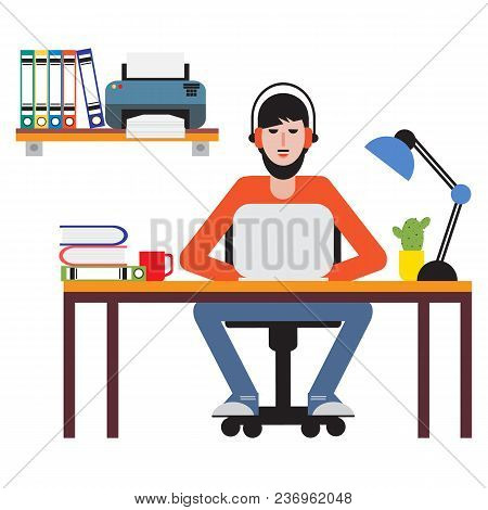 Man Sitting At Table And Working On Laptop. Workspace.