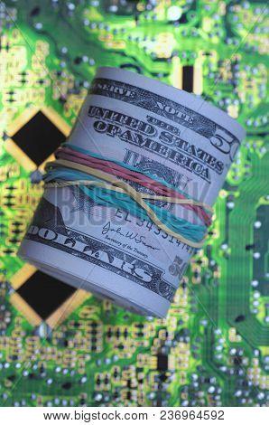Bundle Of Notes On Printed Circuit Board.