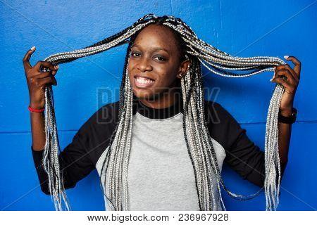 Portrait of a woman with dreadlocks