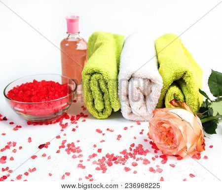 Sea Salt, Towels,dry Bath Bomb, Tea Candles, Aroma Oil In Bottles And Lavender On Background.flat La