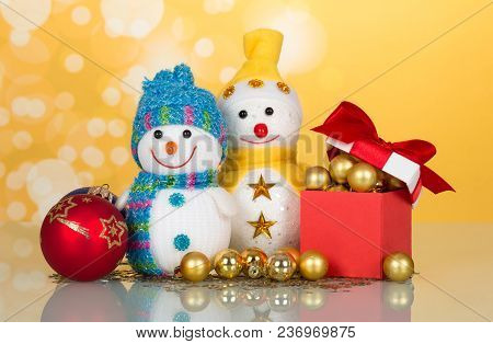 Two Little Funny Snowman, Christmas Toys, Gifts And Surprises, On Bright Yellow Background