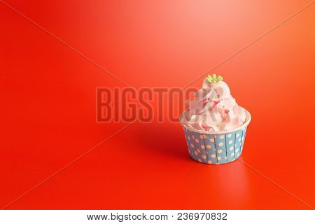 Tasty Birthday Cupcake On Red Color Background