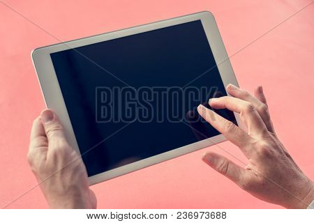 Hands on a mockup copy-space digital device