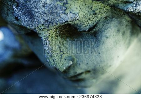 Face Of Sad Guardian Angel. (fragment Of An Antique Statue)