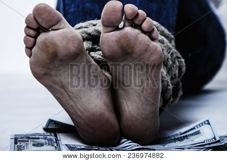 The Legs Of A Woman Bound By The Rope And The Money As Symbol Of Kidnapping, Human Traffick And Vict