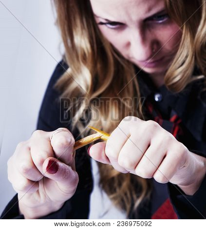 Angers, Stressed And Frustrated Business Woman Breaking The Pencil As A Symbol Of The Problems In Bu
