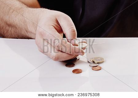 Family Debts. Young Frustrated And Desperate Man Counting Small Money (bankrupt, Poverty, Tax, Money