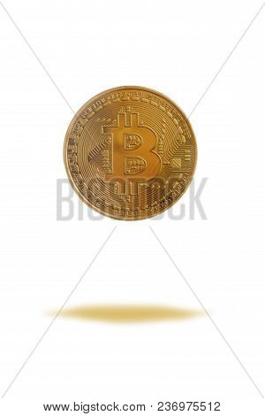 Golden Bitcoin Coin. Close Up Of Digital Crypto Currency Coin With Bitcoin Symbol Isolated On White